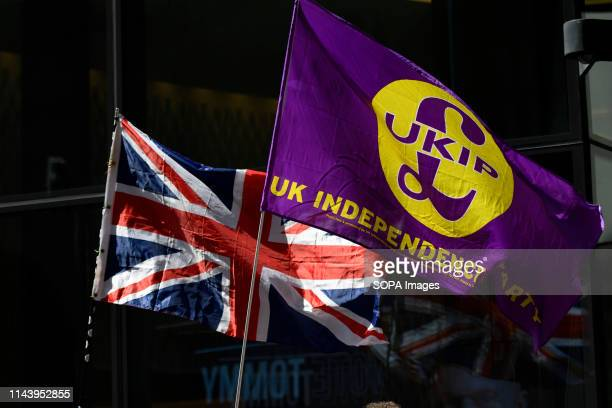 British flag and United Kingdom Independence Party flag are seen outside the Old Bailey during the hearing The rightwing leader Tommy Robinson whose...