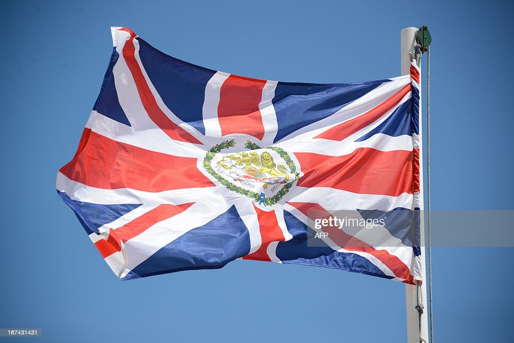A British flag flies near the newly opened British Embassy in Mogadishu on April 25, 2013. British Foreign Secretary William Hague opened a new embassy in Mogadishu on April 25, 22 years after London pulled its diplomats from conflict-torn Somalia. AFP PHOTO / Mohamed Abdiwahab