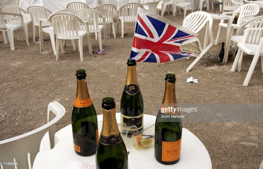 A British flag lies in an empty champagne bottle after the first day of Royal Ascot, at the Ascot Racecourse on June 20, 2006 in Ascot, England. The event has been one of the highlights of the racing and social calendar since 1711, and the royal patronage continues today with a Royal Procession taking place in front of the grandstands daily.