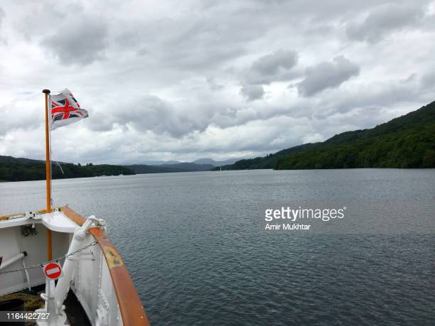 british flag on boat at lake district - bandiera inglese foto e immagini stock