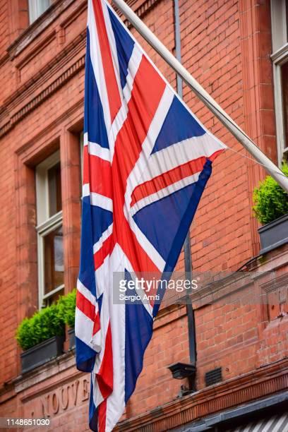 British flag on red brick building