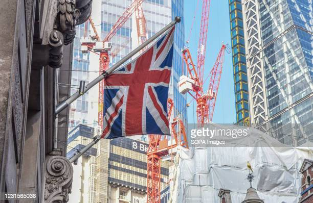 British flag seen hanging on a building in London city.