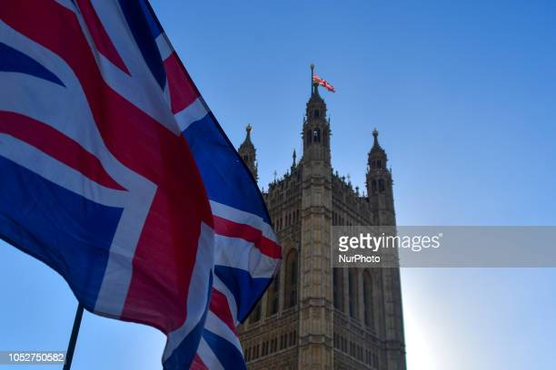 A British flag waves outside the Parliament london on October 22 2018 Theresa May is to tell MPs the Brexit divorce agreement with Brussels is now...