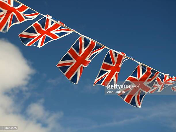 british flags and bunting decoration in jersey - bunting stock pictures, royalty-free photos & images