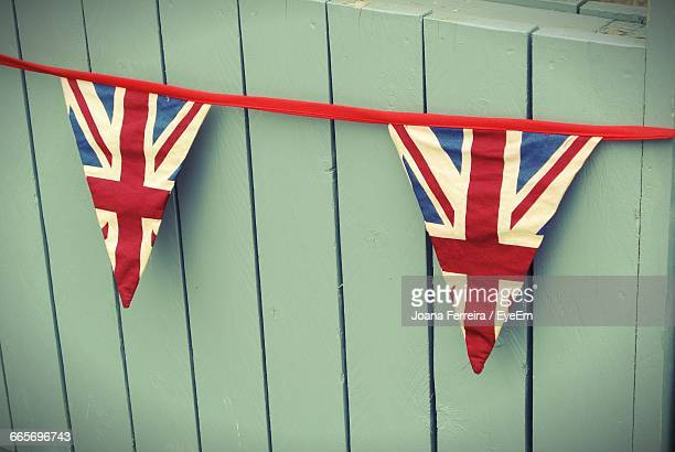 british flags decoration against wooden wall - bunting stock pictures, royalty-free photos & images