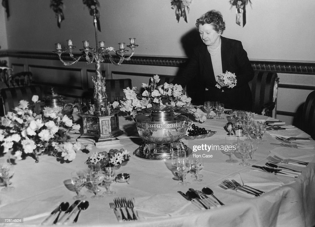 British floral artist Constance Spry (1886 - 1960) decorates the Queen's table at Lancaster House, London, ready for the Coronation Banquet being held there by the Foreign Office in honour of Queen Elizabeth II, 5th June 1953.