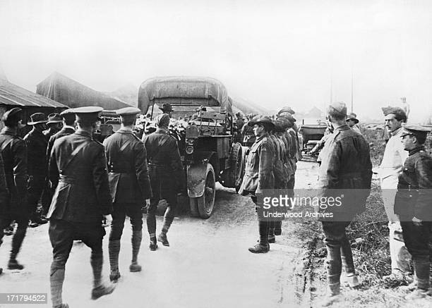 British flying officers are following on foot behind the funeral procession for Manfred von Richthofen the German ace pilot known as the Red Baron...