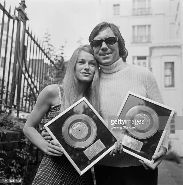 British folk duo Peters and Lee with the Silver Discs awarded for sales of their single 'Welcome Home', UK, 21st July 1973. They are Dianne Lee and...