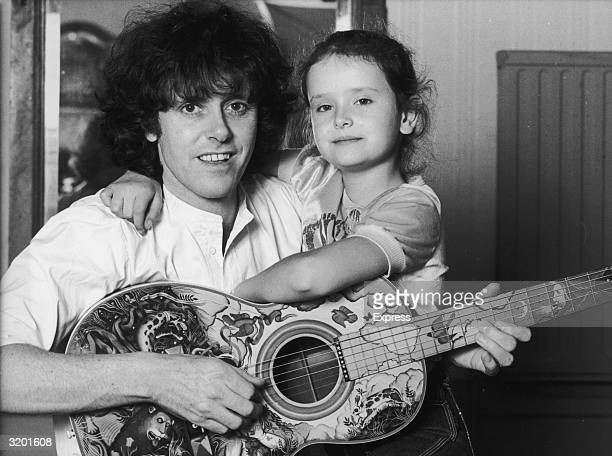 British folkrock singer Donovan poses with his ten year old daughter singer Astella Dee while playing an acoustic guitar Italy Astella performed at...