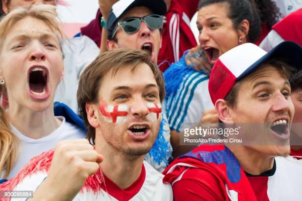 British football fans shouting at match