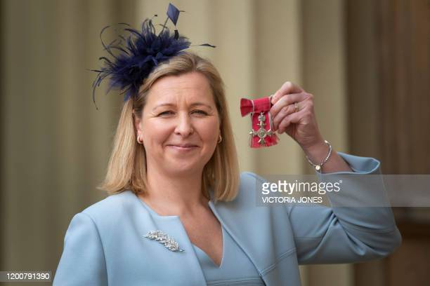 British football manager Jayne Ludlow manager of the Wales Women's football team poses with her medal after she was appointed a Member of the Order...