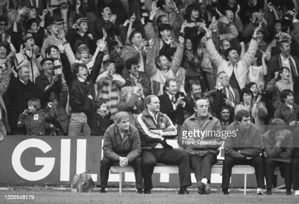 British football manager Ron Atkinson looks on in dismay as the Watford fans behind him celebrate during the First Division match between Watford and...