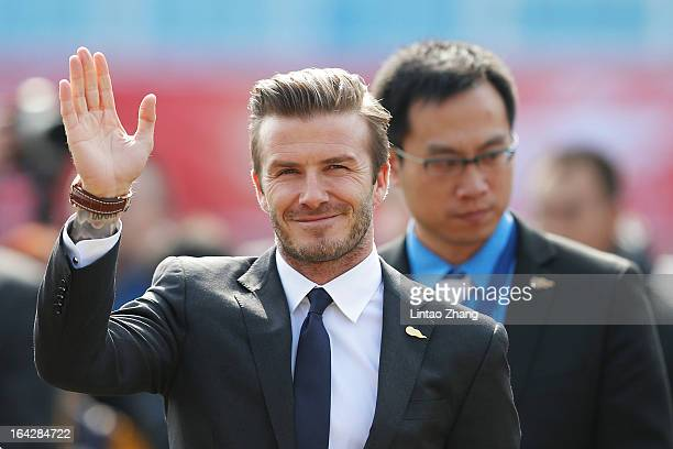 British football player David Beckham arrives at Tiantai Stadium to visit Qingdao Jonoon Football Club at Qingdao Shandong Province on March 22 2013...