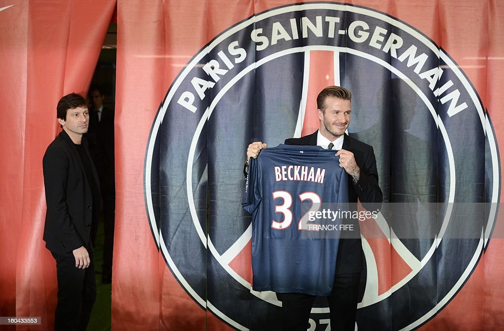 British football player David Beckham (R) poses presenting his new jersey as PSG sports director Leonardo looks on after a press conference on January 31, 2013 at the Parc des Princes stadium in Paris. Beckham signed a five-month deal with the French Ligue 1 football club Paris Saint Germain until the end of June.