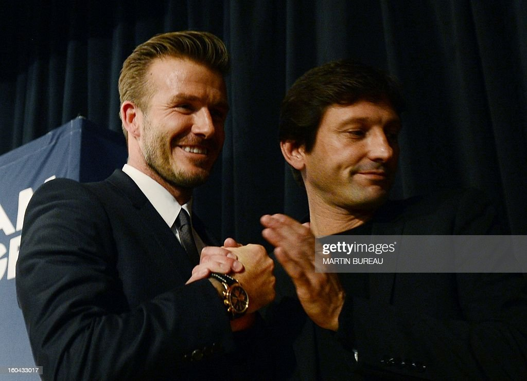 British football player David Beckham (L) shakes hands with PSG Brazilian sport director Leonardo as he leaves a press conference on January 31, 2013 at the Parc des Princes stadium in Paris. Beckham signed a five-month deal with the Ligue 1 leader until the end of June.