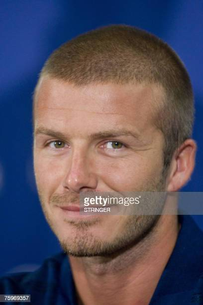 British football star David Beckham smiles at photographers during a press conference at the Air Canada Centre in Toronto 04 August 2007 where he...