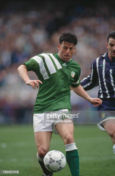 British footballer and captain of the Republic of Ireland team, Andy Townsend makes a run with the ball during the FIFA World Cup group 3 qualifying...