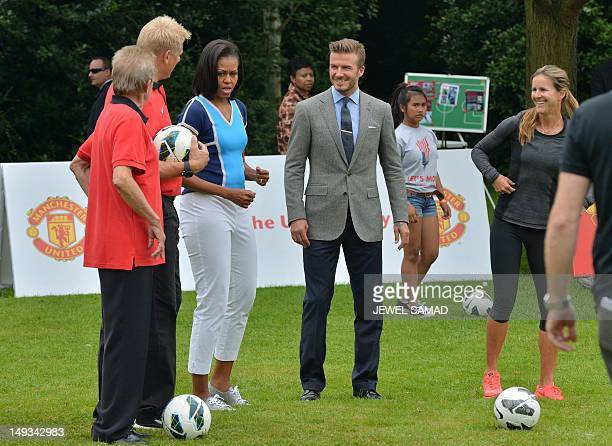 British footballer David Beckham and US First Lady Michelle Obama take part in a 'Let's MoveLondon' event at the Winfield House in London on July 27...