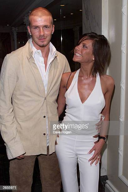 British footballer David Beckham and wife British pop star Victoria Beckham arrive at the Silver Clef Awards held at the Intercontinental Hotel on...