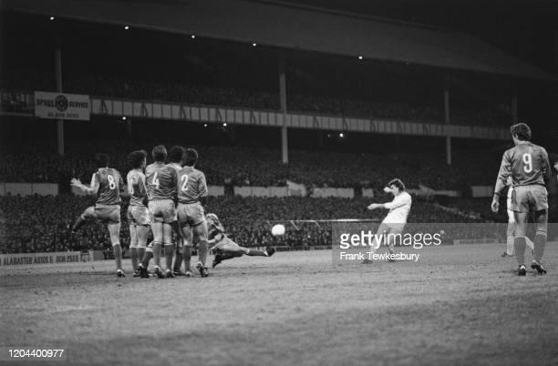 British footballer Glenn Hoddle shoots for Tottenham Hotspur during their UEFA Cup Quarter Final, First Leg, against Real Madrid at White Hart Lane...
