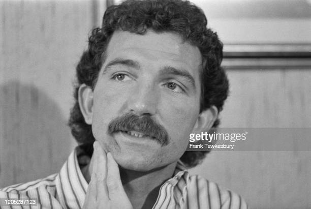 British footballer Graeme Souness scratches his chin at the launch of his autobiography, 'No Half Measures', United Kingdom, 18th March 1985.