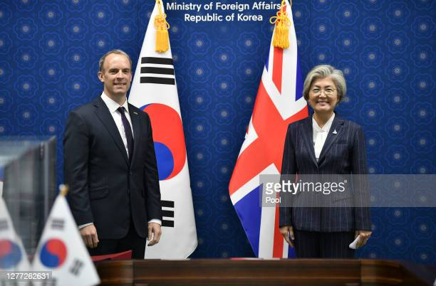 British Foreign Minister Dominic Raab poses with South Korean Foreign Minister Kang Kyung-wha during their meeting at foreign ministry on September...