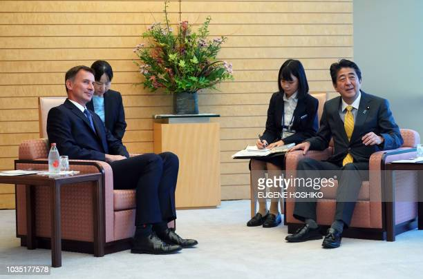 British Foreign Minister Jeremy Hunt and Japanese Prime Minister Shinzo Abe meet during a courtesy call at Abe's official residence in Tokyo on...