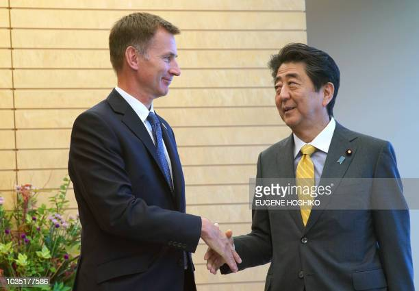 British Foreign Minister Jeremy Hunt and Japanese Prime Minister Shinzo Abe shake hands during a courtesy call at Abe's official residence in Tokyo...