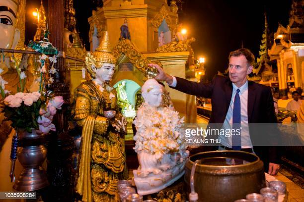 British foreign minister Jeremy Hunt visits the Shwedagon pagoda in Yangon on September 19 2018 Hunt arrived in Myanmar on September 19 for a busy...
