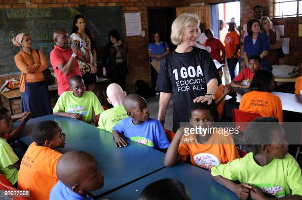 British Foreign Office Minister for Africa Baroness Glenys Kinnock meets with pupils of Winnie Ngwekasi Primary School in Soweto on November 3 2009...