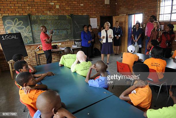 British Foreign Office Minister for Africa Baroness Glenys Kinnock speaks to pupils of Winnie Ngwekasi Primary School in Soweto on November 3 2009...