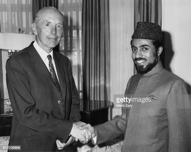 British Foreign Secretary Alec DouglasHome meets Sheikh Qaboos bin Said al Said the Sultan of Oman at Claridge's Hotel in London where they are...