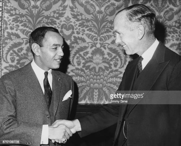 British Foreign Secretary Alec DouglasHome shakes hands with Crown Prince Moulay Hassan ben Mohammed of Morocco at the Foreign Office in London 26th...