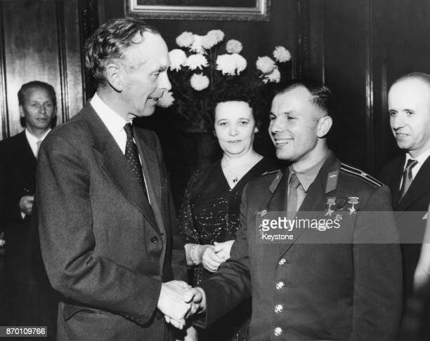 British Foreign Secretary Alec DouglasHome shakes hands with Soviet cosmonaut Yuri Gagarin during a reception in Gagarin's honour at the Russian...