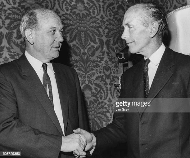 British Foreign Secretary Alec DouglasHome shaking hands with his US counterpart Dean Rusk at the Foreign Office London June 27th 1963