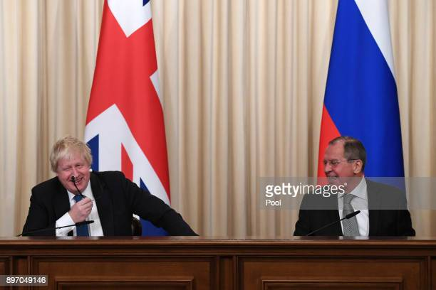 British Foreign Secretary Boris Johnson and Russian counterpart Sergei Lavrov laugh during a press conference after their meeting on December 22 2017...