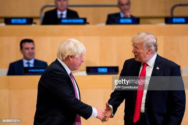 British Foreign Secretary Boris Johnson and US President Donald Trump greet before a meeting on United Nations Reform at UN headquarters in New York...