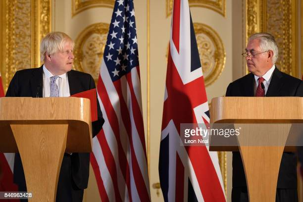 British Foreign Secretary Boris Johnson and US Secretary of State Rex Tillerson speak at a press conference in Lancaster House following a meeting on...
