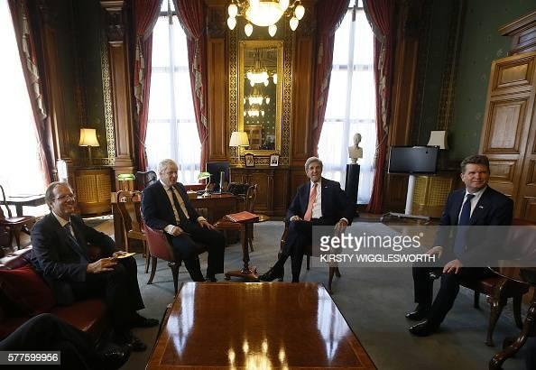 British Foreign Secretary Boris Johnson (2L), attends a ...