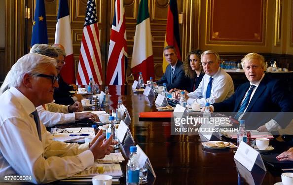 British Foreign Secretary Boris Johnson (R) chairs a ...
