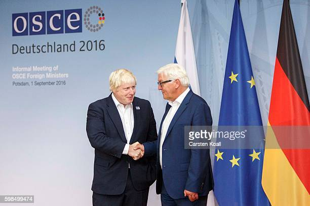 British Foreign Secretary Boris Johnson chats with German Foreign Minister FrankWalter Steinmeier at a conference of OSCE members states on September...