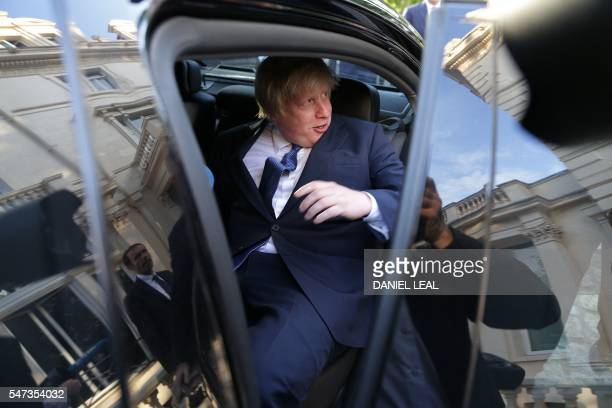 British Foreign Secretary Boris Johnson gets into a car as he leaves after attending an event at the French Ambassador's residence in west London on...