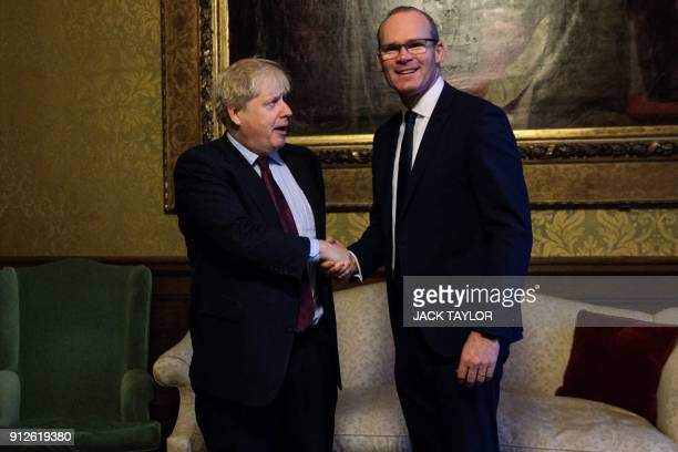 British Foreign Secretary Boris Johnson greets the Irish Foreign Minister Simon Coveney at the Foreign and Commonwealth Office in London on January...
