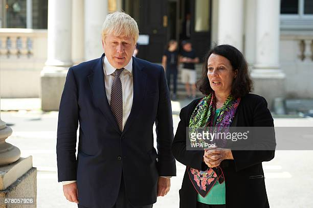 British Foreign Secretary Boris Johnson is greeted by French ambasador to Britain Sylvie Bermann as he arrives to sign a book of condolence at the...