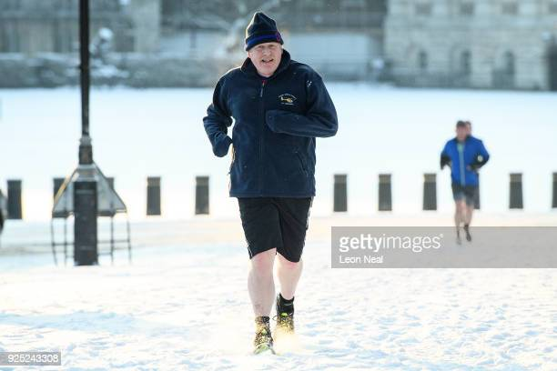 British Foreign Secretary Boris Johnson jogs through the snow near St James Park on February 28 2018 in London England A letter from Mr Johnson to...
