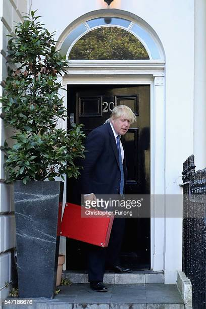 British Foreign Secretary Boris Johnson leaves his home on his first day as one of Prime Minister Theresa May's cabinet on July 14 2016 in London...