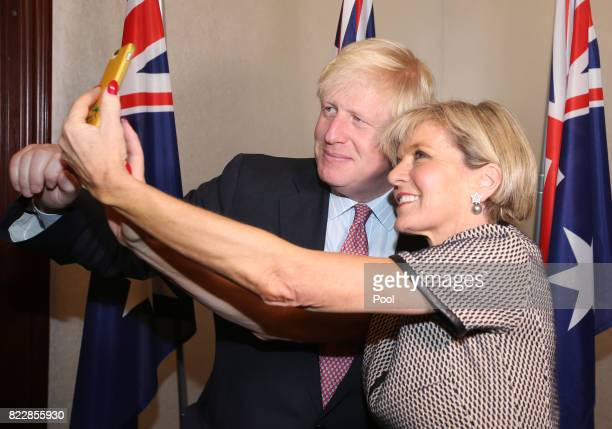 British Foreign Secretary Boris Johnson left has a selfie photo taken with Australian Foreign Minister Julie Bishop ahead of their bilateral meeting...
