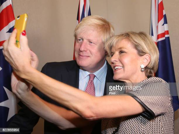 British Foreign Secretary Boris Johnson left has a 'selfie' photo taken with Australian Foreign Minister Julie Bishop ahead of their bilateral...