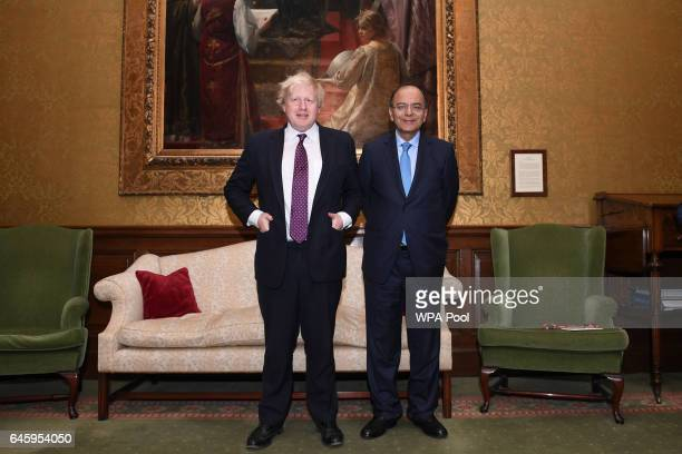 British Foreign Secretary Boris Johnson poses with India's Minister of Finance Arun Jaitley at the Foreign Office on February 27 2017 in London...