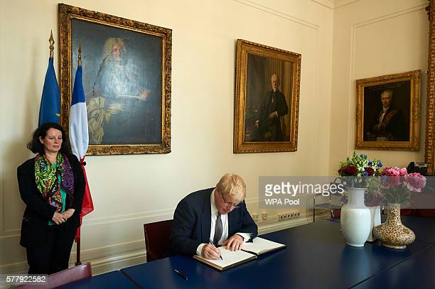 British Foreign Secretary Boris Johnson signs a book of condolence at the French embassy to commemorate the victims of the attack in Nice that killed...